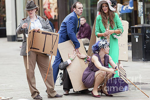 Placard waving angry mob in high street by Simon Bratt Photography LRPS