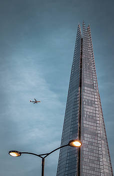 Plane Flying over London by Marius Comanescu