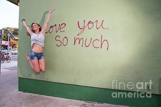 Herronstock Prints - Playful local South Austin woman jumps for joy at the i love you so much