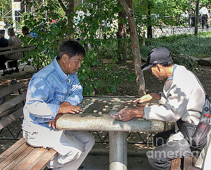 Playing chinese chess in the park by Patricia Hofmeester