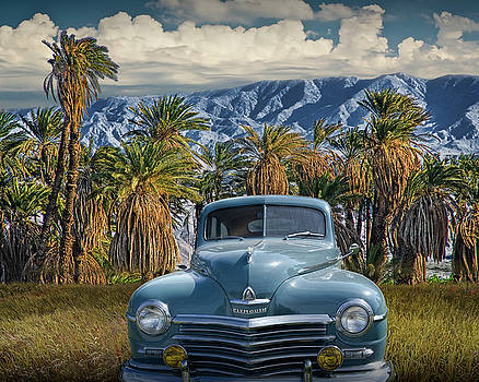 Randall Nyhof - Plymouth Automobile with Palm Trees and Cloudy Blue Sky near Palm Springs