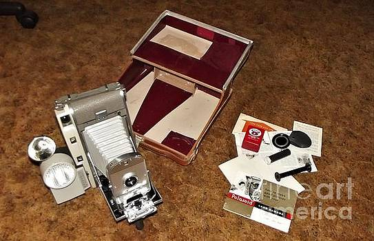 Polaroid Land Camera Model 800 with Accessories and  Leather Case                  Antique           by Rory Cubel