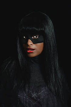 Portrait of Black woman weth mask.  by Stuart Brown