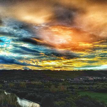 Post Flash Flood Sunset by Travis Turner