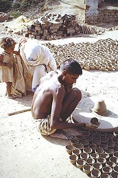 Potter, Indian village by Barron Holland