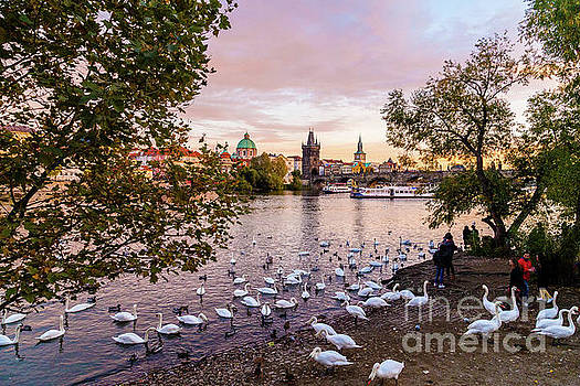 Prague at sunset from the river by Travel and Destinations - By Mike Clegg