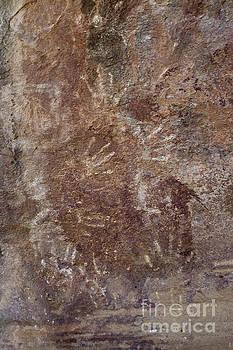 Prehistoric hand impressions by Hitendra SINKAR