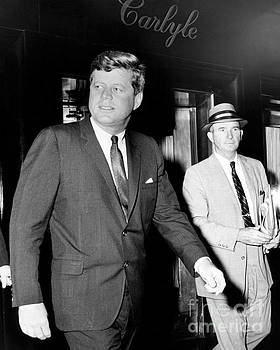 President John Kennedy on his way to La Guardia Marine terminal 1962. by Barney Stein