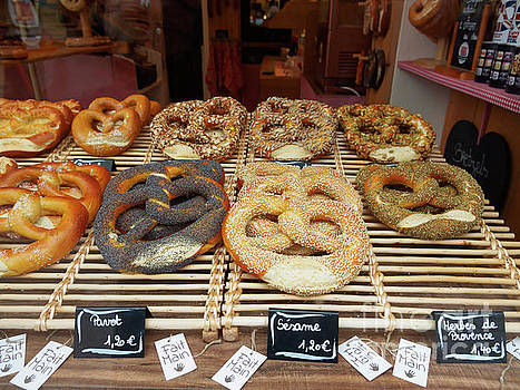 Prezels on display in a bake shop in Strasbourg France by Louise Heusinkveld
