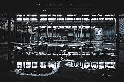 Puddles and Reflections In Abandoned Building by Dylan Murphy