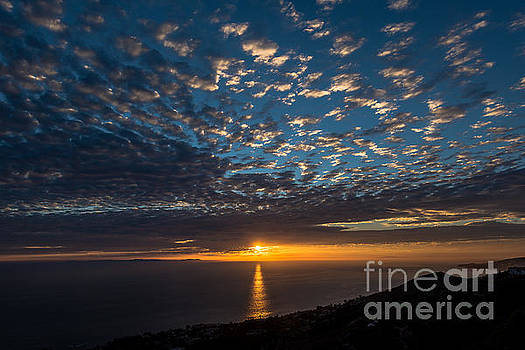 Puffy Blue Sunset by Gregory Lee Schaffer