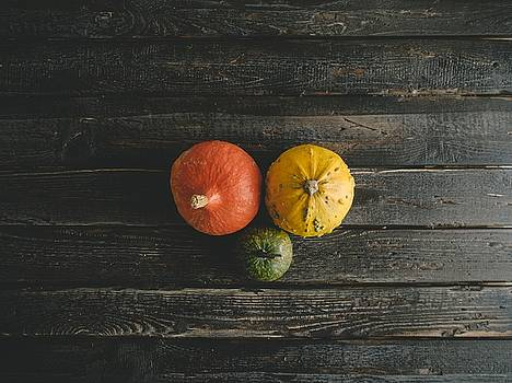 Pumpkins On A Wooden Table by Fine Art Photography
