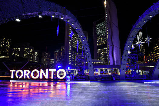 Reimar Gaertner - Purple arches at ice rink of Nathan Phillips Square at night wit