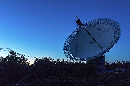 Radio telescope at dusk by Josef Pittner