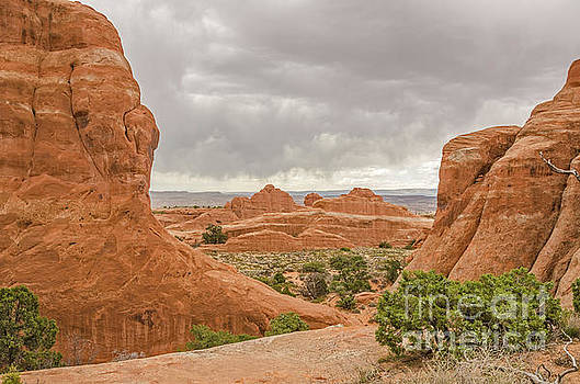 Rain in the Distance at Arches by Sue Smith