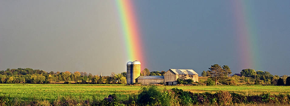 Rainbow over barn silo by Peter Pauer