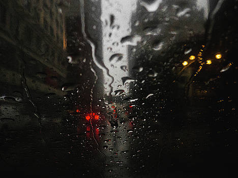 Raindrops on car window by Dylan Murphy