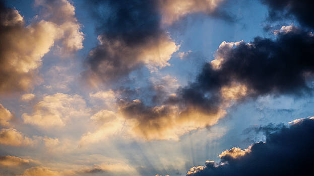 Rays and clouds by Kelvin Trundle