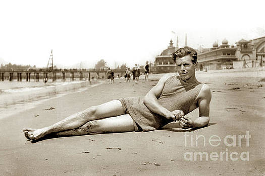 Reclining bather in the water's edge on the beach at Santa Cruz by California Views Mr Pat Hathaway Archives