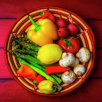 Red And White Basket Of Vegetables by Garry Gay