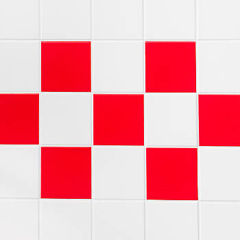 Red and white tiles by Tom Gowanlock