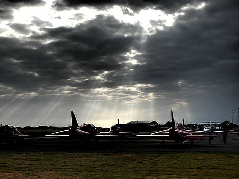 Red Arrows under the Moody sky by Christopher Beardall