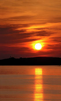 Reimar Gaertner - Red ball sunset and reflection from Rocky Harbour Newfoundland w