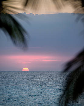 Reimar Gaertner - Red ball sunset sinking below horizon over the Atlantic Ocean in