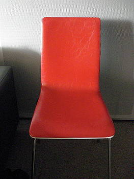 Red Chair in Oz by Derrick Anderson