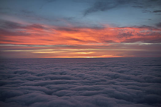Reimar Gaertner - Red cloud sunrise above the clouds from a jet airplane