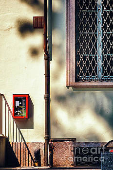 Silvia Ganora - Red fire box with window, shadows and gutter