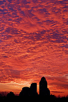 Reimar Gaertner - Red firey clouds at sunset with silhouette buildings
