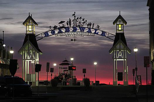 Red Horizon Thru The Boardwalk Arch by Robert Banach