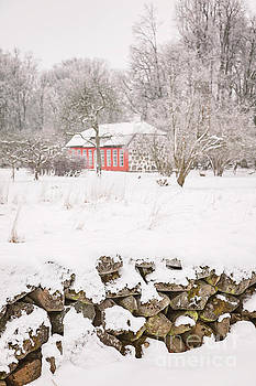 Red house in the snow by Sophie McAulay