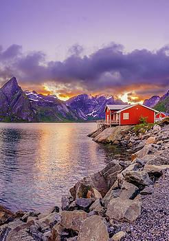 Red hut in a midnight sun by Dmytro Korol