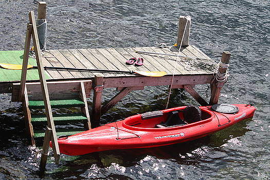 Red kayak at dock by Denise Jenks