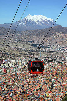 Red Line Cable Car Cabin and Mt Illimani Bolivia by James Brunker
