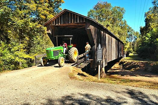 Red Oak Creek Covered Bridge And Tractor by James Potts