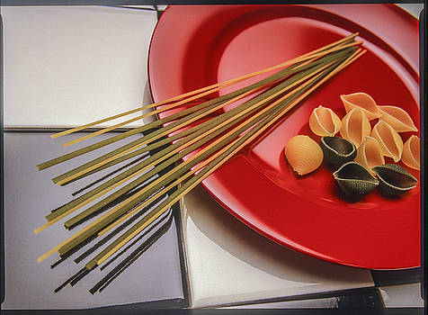Red plate pasta by Roy Inman