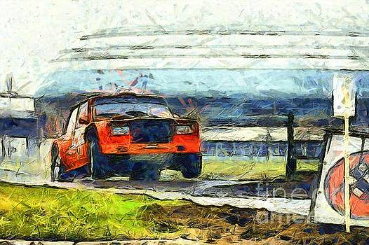 Red rally car jump by Magomed Magomedagaev