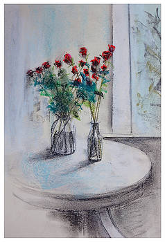 Red  roses on table by Natalia Stahl