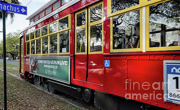 Kathleen K Parker - Red Streetcar Speeds By NOLA-2