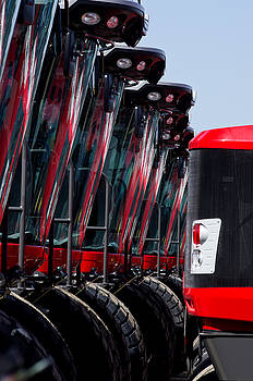 Red Tractors by Kevin Duke