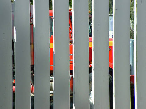 Red Truck Through a 2X6 Fence by Stan  Magnan