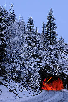 Reimar Gaertner - Red Wawona Road tunnel and blue snow covered mountain at dawn in