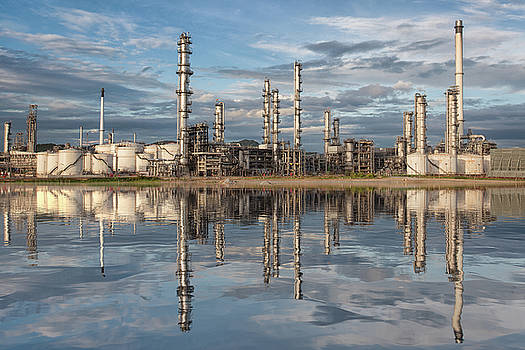 Reflection of oil refinery factory by Anek Suwannaphoom