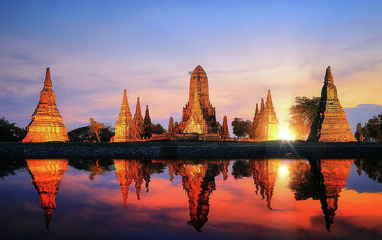 Reflection of pagoda and old temple in Ayutthaya ancient city pa by Anek Suwannaphoom