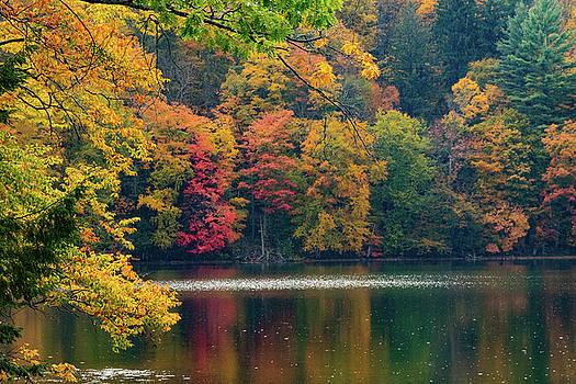 Reflection on Pogue pond Vermont by Jeff Folger