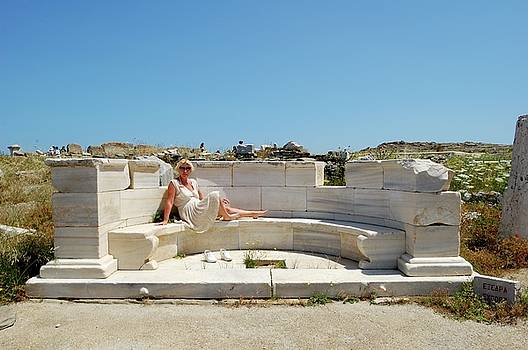 Relax on an antique marble bench  by Yuri Hope