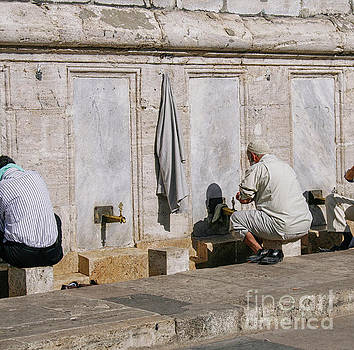 Religious Men Washing Feet Near Mosque by Patricia Hofmeester